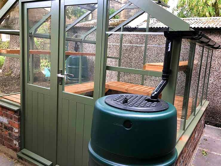 Greenhouse with water barrel